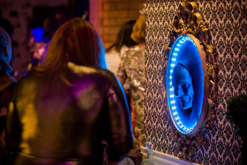 This interactive character installation is called Mirror Mirror and was provided by Enticing Entertainment for their Alice in Wonderland themed event for New Years Eve at the Hewing Hotel in Minneapolis. This comedic character is similar to the talking mirror from Snow White.