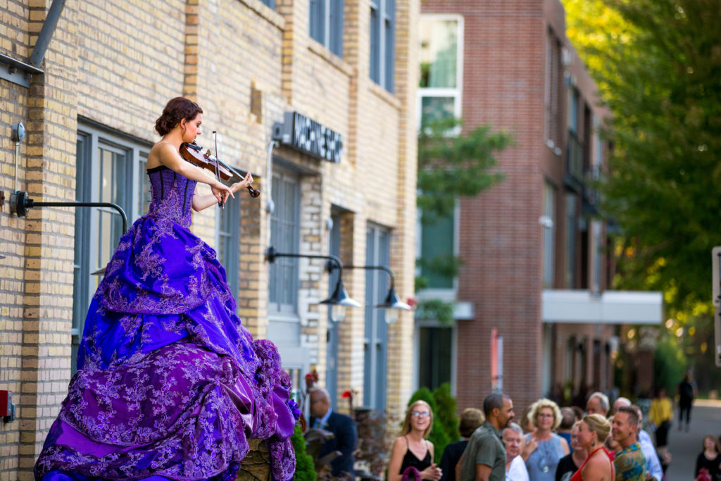 Purple Violinist Archway- Enticing Entertainment Showcase - Experience the Seasons